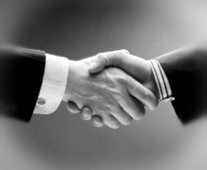 Picture of a corporate handshake to symbolise meeting the team