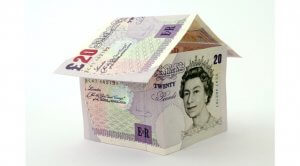 Picture of a house made from money to signify an investment property