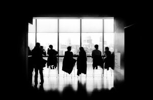 Picture showing people around a meeting room table